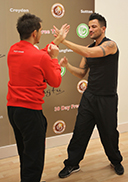 Master Paul Hawkes and Peter Andre practicing their Wing Chun during the National franchise launch at Kung Fu Schools Croydon